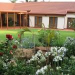 Touraco Gästehaus - Garten